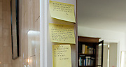 "March 6, 2015, Paris, France. Post-it notes decorate the Paris' apartment where Georges and Maryse Wolinski used to live. French Cartoonist Georges Wolinski (1934 –2015) wrote daily post-it notes to his wife Maryse Wolinski (1943, Algiers). Two month after the death of Georges Wolinski, the apartment is full of souvenirs and notes, attesting a half-century-long love relation: ""Good night, Maryse, darling, I love you since 44 years and it is not over yet. G. ""<br /> ""Honey, it's 9 o'clock, my drawing and my apple are finished. I think of you. I'm going to fall asleep with my book. We need travel, love and holidays. I love you, G.""<br /> Darling, I think of you, I'm worried about you. I love you. Georges.""  <br /> The cartoonist Georges Wolinski was 80 years old when he was murdered by the French jihadists Chérif en Saïd Kouachi, he was one of the 12 victims of the massacre in the Charlie Hebdo offices on January 7, 2015 in Paris. Charlie Hebdo published caricatures of Mohammed, considered blasphemous by some Muslims. During his life, Georges Wolinski defended freedom, secularism and humour and was one of the major political cartoonists in France. The couple was married and had lived for 47 years together. Photo: Steven Wassenaar."