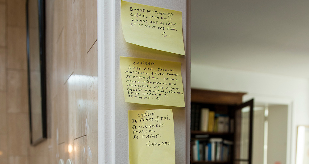 March 6, 2015, Paris, France. Post-it notes decorate the Paris&rsquo; apartment where Georges and Maryse Wolinski used to live. French Cartoonist Georges Wolinski (1934 &ndash;2015) wrote daily post-it notes to his wife Maryse Wolinski (1943, Algiers). Two month after the death of Georges Wolinski, the apartment is full of souvenirs and notes, attesting a half-century-long love relation: &quot;Good night, Maryse, darling, I love you since 44 years and it is not over yet. G. &quot;<br /> &quot;Honey, it's 9 o'clock, my drawing and my apple are finished. I think of you. I'm going to fall asleep with my book. We need travel, love and holidays. I love you, G.&rdquo;<br /> Darling, I think of you, I'm worried about you. I love you. Georges.&rdquo;  <br /> The cartoonist Georges Wolinski was 80 years old when he was murdered by the French jihadists Ch&eacute;rif en Sa&iuml;d Kouachi, he was one of the 12 victims of the massacre in the Charlie Hebdo offices on January 7, 2015 in Paris. Charlie Hebdo published caricatures of Mohammed, considered blasphemous by some Muslims. During his life, Georges Wolinski defended freedom, secularism and humour and was one of the major political cartoonists in France. The couple was married and had lived for 47 years together. Photo: Steven Wassenaar.
