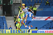 Brighton central midfielder, Beram Kayal (7) challenges Huddersfield Town midfielder Emyr Huws (16) in the air during the Sky Bet Championship match between Brighton and Hove Albion and Huddersfield Town at the American Express Community Stadium, Brighton and Hove, England on 23 January 2016. Photo by Geoff Penn.