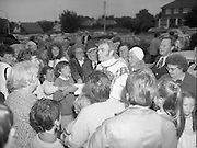 "Fr Niall O'Brien says Thanksgiving Mass.1984..16.07.1984..07.16.1984..16th July 1984..In celebration of his safe homecoming from the Philippines,Fr Niall O'Brien said a thanksgiving mass At Newtownpark Ave,Blackrock,Dublin. Along with two other priests and six lay people,Fr Niall was falsly accused of multiple murders.They became known as ""The Negros Nine"".After President Reagan visited Ireland,The American government put pressure on the Marcos regime and all charges were dropped and all were fully exonerated....Photograph taken as Fr O'Brien is mobbed by well wishers after the mass in Blackrock...Note; Fr O'Brien, who was born in Dublin in 1939,died in Pisa, Italy in 2004"