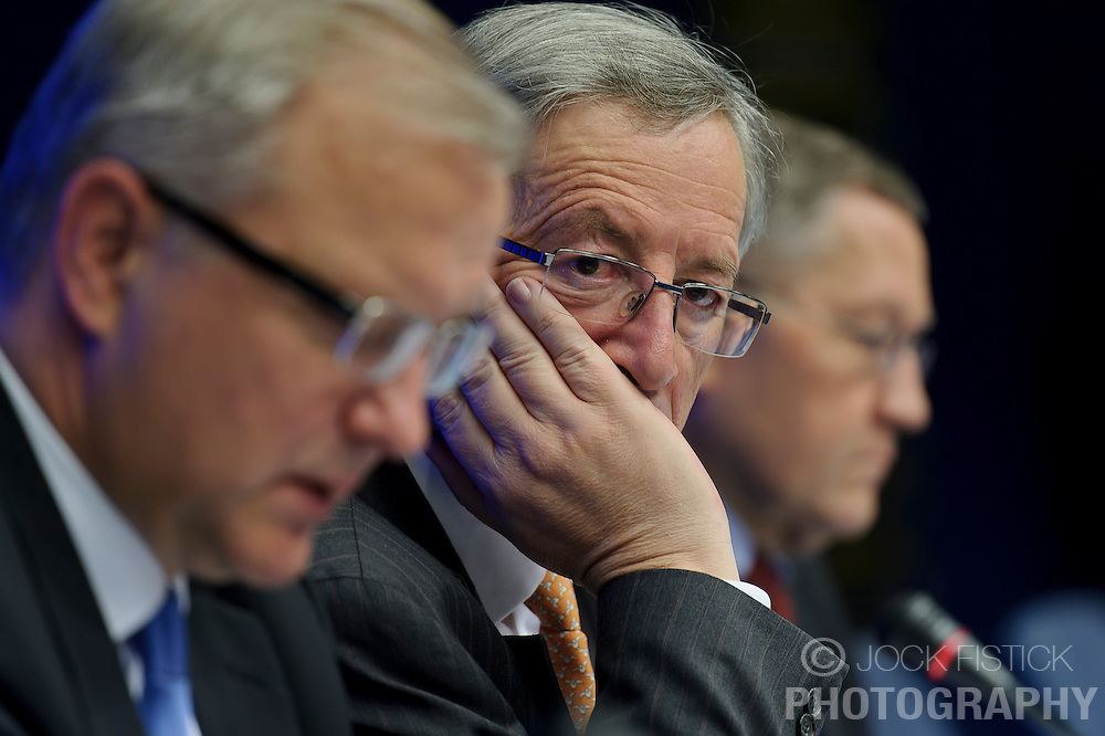 Jean-Claude Juncker, Luxembourg's prime minister, and president of the Eurogroup, center, listens during a joint press conference with Olli Rehn, The EU's economic and monetary affairs commissioner, left, and Klaus Regling, chief executive officer of the European Financial Stability Fund (EFSF), right, following the Eurogroup meeting in Brussels, Monday Dec. 6, 2010.  (Photo © Jock Fistick).