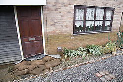 Sandbags lined up in front of a door to reduce flooding during the floods at Toll Bar; South Yorkshire; July 2007,