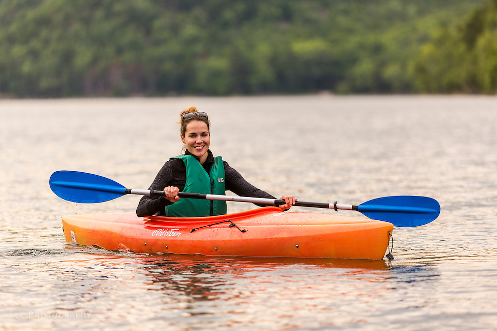 A woman kayaking on Jordan Pond in Maine's Acadia National Park.