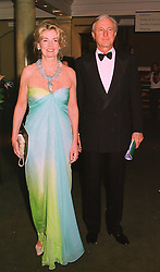 MR & MRS GALEN WESTON, he is the Canadian multi-millionaire, at a dinner in London on 19th May 1998.MHS 37