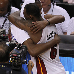 Jun 21, 2012; Miami, FL, USA; Miami Heat small forward LeBron James (6) hugs Oklahoma City Thunder small forward Kevin Durant (35) after winning the 2012 NBA championship at the American Airlines Arena. Miami won 121-106. Mandatory Credit: Derick E. Hingle-US PRESSWIRE