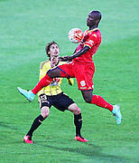 Adelaide United's Bruce Djite brings down a high ball infront of Phoenix' Albert Riera during the Round 22 A-League football match - Wellington Phoenix V Adelaide United at Westpac Stadium, Wellington. Saturday 5th March 2016. Copyright Photo.: Grant Down / www.photosport.nz