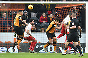 Hull City defender Curtis Davies (6) heads towards goal  during the Sky Bet Championship match between Hull City and Charlton Athletic at the KC Stadium, Kingston upon Hull, England on 16 January 2016. Photo by Ian Lyall.