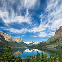 wispy clouds above saint mary lake and wild goose island, glacier national park
