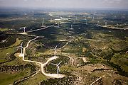 Lines of windmills run perpendicular to the prevailing wind.