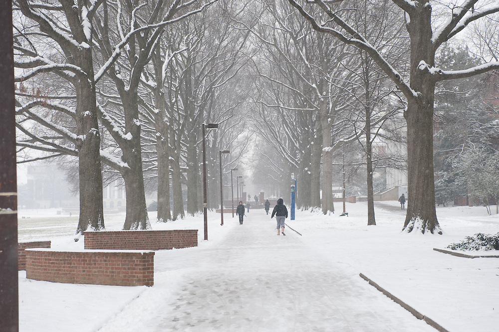 People on campus snow covered walkway