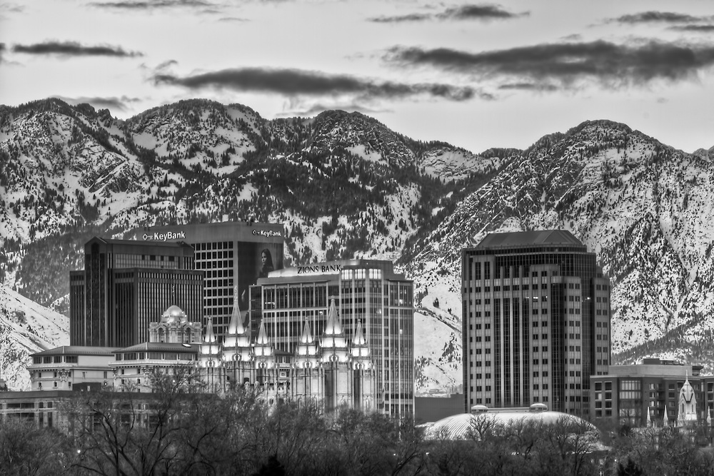 Downtown Salt Lake City, Utah against a snowy backdrop of the Wasatch Mountains.