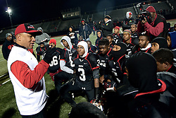 After the game, Coach Albie Crosby tells the team to report for practice on Monday so they can get ready for the upcoming game vs. West Catholic, the school where he served as assistant coach before coming to Imhotep. (Bas Slabbers/for NewsWorks)