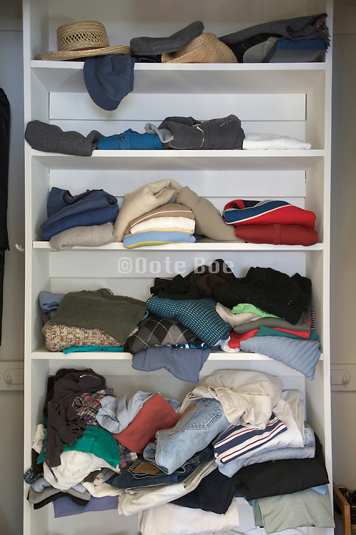 a messy clothing closet