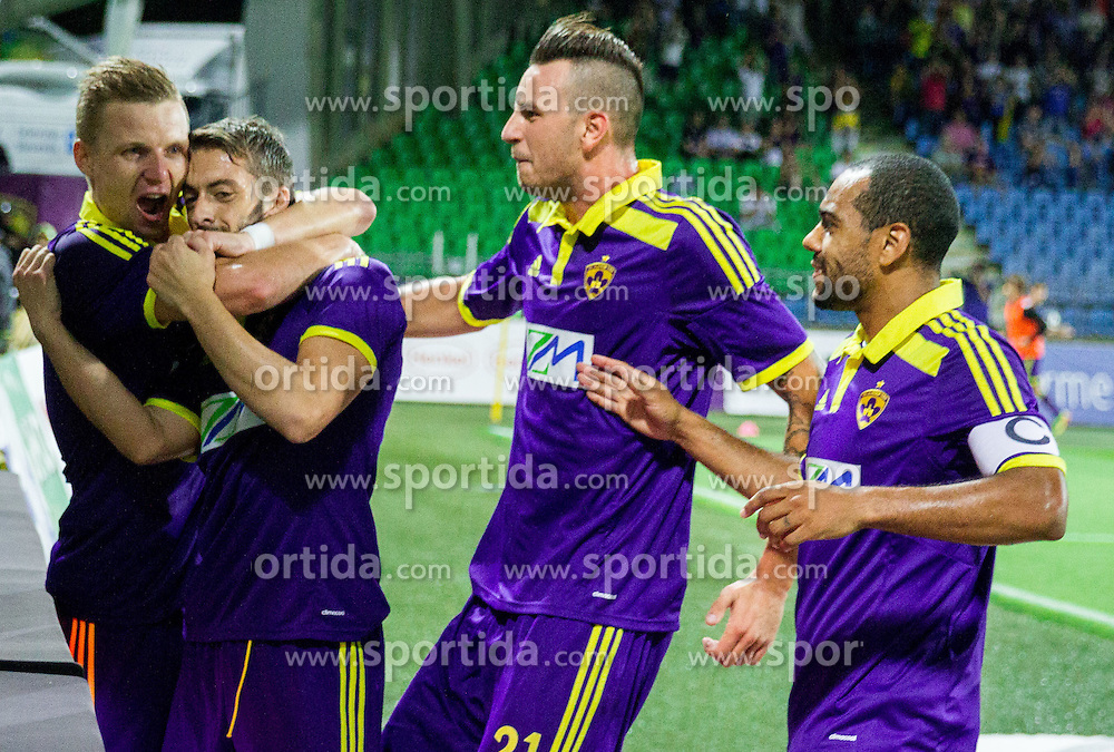 Dare Vrsic #22 of Maribor, Agim Ibraimi #10 of Maribor, Amir Dervisevic #21 of Maribor and Marcos Tavares #9 of Maribor celebrate after scoring second goal for Maribor during 2nd Leg football match between NK Maribor and HSK Zrinjski Mostar in Second Qualifying Round of UEFA Champions League 2014/15, on July 23, 2014 in Stadium Ljudski vrt, Maribor, Slovenia. Photo by Vid Ponikvar / Sportida.com