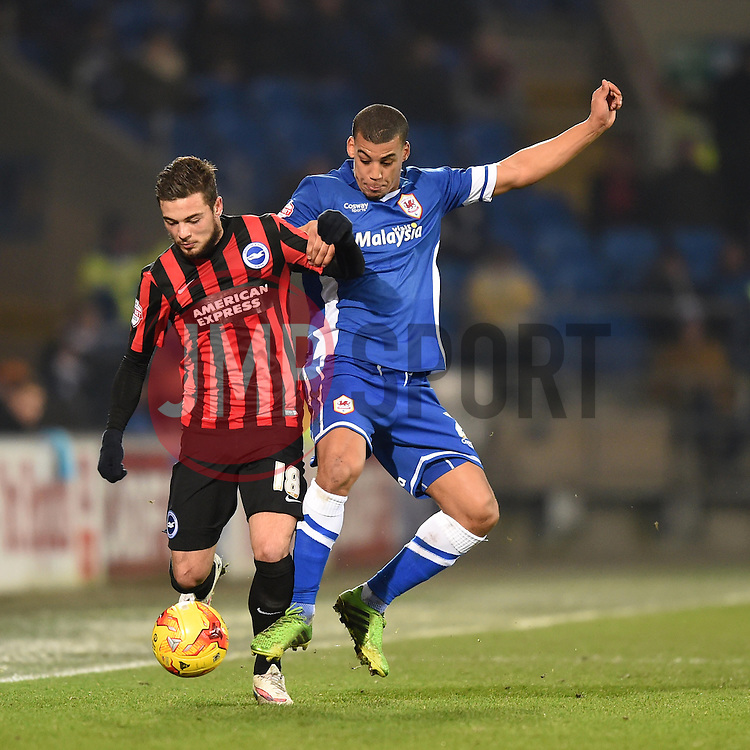 Brighton and Hove Albion's Jake Forster-Caskey and Cardiff City's Lee Peltier compete for the ball - Photo mandatory by-line: Paul Knight/JMP - Mobile: 07966 386802 - 10/02/2015 - SPORT - Football - Cardiff - Cardiff City Stadium - Cardiff City v Brighton & Hove Albion - Sky Bet Championship