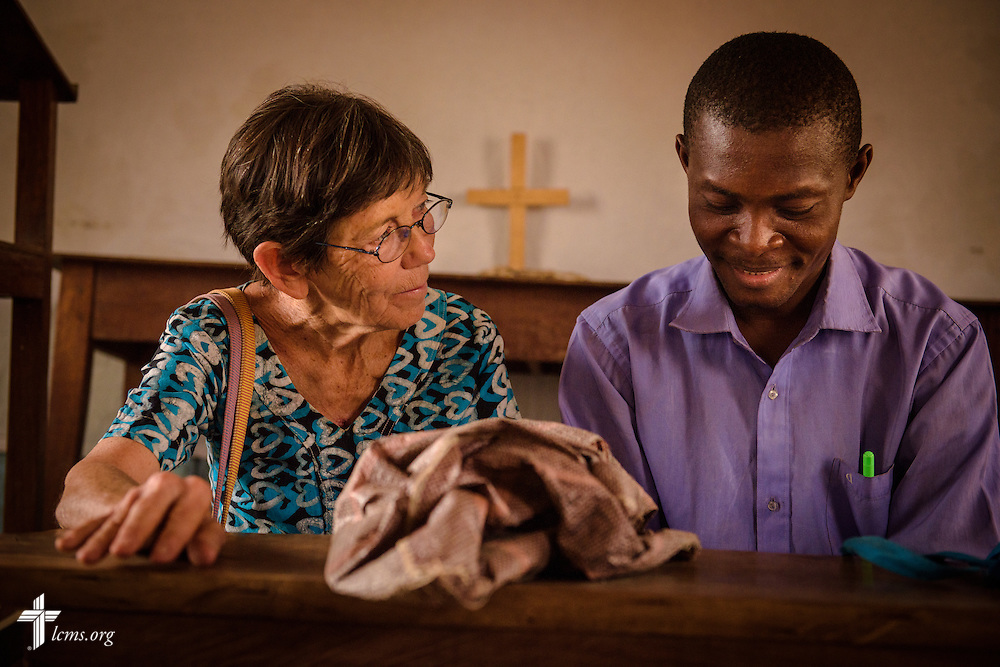 Valerie Stonebreaker, LCMS missionary to Togo, confers with Vicar Djekoab Yantchiemaen following Bible study at the Lutheran Church of Togo in Lokpano on Monday, Feb. 13, 2017, in Lokpano, Togo. Yantchiemaen graduated at the Lutheran Center for Theological Studies (CLET) in Dapaong. LCMS Communications/Erik M. Lunsford