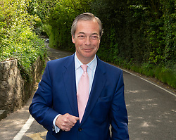 © Licensed to London News Pictures. 23/05/2019.<br /> Downe,UK. Mr Farage walking to the polling station. Brexit Party leader Nigel Farage voting in the European elections at Cudham C of E primary school, Downe, Kent. Photo credit: Grant Falvey/LNP