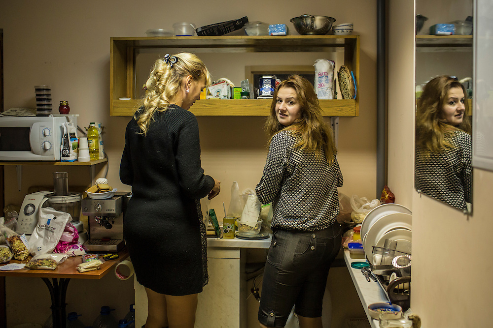 DNIPROPETROVSK, UKRAINE - NOVEMBER 16, 2014:  Tatyana Sirko, 42, a gynecologist, left, and Alyona Fedorenko, 36, an economist, right, package the dried ingredients for traditional borscht soup in the kitchen at the Dnipropetrovsk Volunteer Logistics Center, a charity organization that produces supplies for pro-Ukrainian fighters battling rebels in the country's East, in Dnipropetrovsk, Ukraine. CREDIT: Brendan Hoffman for The New York Times