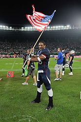 16.07.2011, Ernst Happel Stadion, Wien, AUT, American Football WM 2011, Germany (GER) vs France (FRA), im Bild jubelt mit der amerikanischen Flagge Da'Shawn Thomas (USA, #25, RB) // during the American Football World Championship 2011 game, Germany vs France, at Ernst Happel Stadion, Wien, 2011-07-16, EXPA Pictures © 2011, PhotoCredit: EXPA/ G. Holoubek