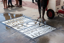 © Licensed to London News Pictures. 10/08/2018. Bristol, UK. Our Future, Our Choice (OFOC), launches an environmentally friendly pressure campaign using so-called 'clean graffiti,' applying a pressure washer to pavement to etch a pro-People's Vote messaging in the pavement via cleaning away residue.The stencil is a message on the streets of Bristol, a warning that Bristol must rise up against Brexit or Brexit will break Bristol. Bristol voted by a substantial majority to remain in the EU referendum. OFOC is a group of young pro-EU activists and the largest youth group campaigning for a People's Vote. The OFOC stencil is a prelude to Saturday 11 August, when the People's Vote campaign will hold a massive rally in Bristol including Lib Dem leader Vince Cable. Photo credit: Simon Chapman/LNP