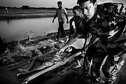 In late August, the Kosi River in India overflowed its banks in the state of Bihar after severe monsoon rains caused a dam to burst in neighboring Nepal, triggering what officials are calling the worst floods in 50 years..India was grappling with the task of feeding and housing close to a million villagers displaced by huge floods in the eastern state of Bihar, as the rescue effort wound down. Some 900,000 people fled from their homes or were evacuated by boat since the Kosi river breached its defences three weeks ago on the Nepal border and changed course.September 9, 2008 A young boy, victim of the flood, at a medical centre in Sapual district in India's northeastern state of Bihar..