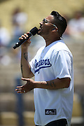 LOS ANGELES, CA - JUNE 15:  Francisco Javier Bautista, Jr., also known as Frankie J, sings the National Anthem before the Los Angeles Dodgers game against the Arizona Diamondbacks at Dodger Stadium on Sunday, June 15, 2014 in Los Angeles, California. The Diamondbacks won the game 6-3. (Photo by Paul Spinelli/MLB Photos via Getty Images) *** Local Caption *** Frankie J