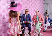 Celebrity judges Simon Baker, center, and Carson Kressley, right, judge the Longines Kentucky Oaks Fashion Contest on Kentucky Oaks Day, Friday, May 2, 2014, in Louisville, Ky.  Longines, the Swiss watch manufacturer known for its luxury timepieces, is the Official Watch and Timekeeper of the 140th annual Kentucky Derby.  (Photo by Diane Bondareff/Invision for Longines/AP Images)