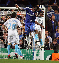 28.09.2010, Stamford Bridge, London, ENG, UEFA Champions League, Chelsea vs Olympique Marseille, im Bild .Michael Essien of Chelsea  with Alex of Chelsea head the ball to deny OM's Andre Ayew     during the Match Chelsea v Marseille, Group F, of  the UCL ( Uefa Champions League Group stages)  at Stamford Bridge in London. EXPA Pictures © 2010, PhotoCredit: EXPA/ IPS/ Marcello Pozzetti +++++ ATTENTION - OUT OF ENGLAND/UK +++++ / SPORTIDA PHOTO AGENCY