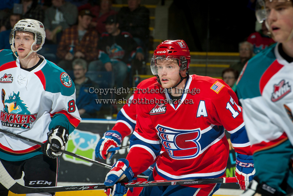 KELOWNA, CANADA - MARCH 5: Mitch Holmberg #17 of the Spokane Chiefs skates between Colten Martin #8 and Damon Severson #7 of the Kelowna Rockets during second period on March 5, 2014 at Prospera Place in Kelowna, British Columbia, Canada.   (Photo by Marissa Baecker/Getty Images)  *** Local Caption *** Mitch Holmberg; Colten Martin; Damon Severson;