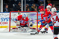 KELOWNA, CANADA - MARCH 13:  Bailey Brkin #31 of the Spokane Chiefs makes a third period save against the Kelowna Rockets on March 13, 2019 at Prospera Place in Kelowna, British Columbia, Canada.  (Photo by Marissa Baecker/Shoot the Breeze)