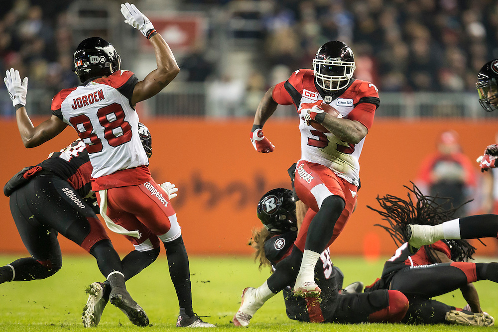 Jerome Messam of the Calgary Stampeders runs the ball during the 1st quarter of the 104th Grey Cup against the Ottawa Redblacks in Toronto Ontario, Sunday,  November 27, 2016.  (CFL PHOTO - Geoff Robins)