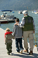 Grandfather Taking Grandsons Fishing