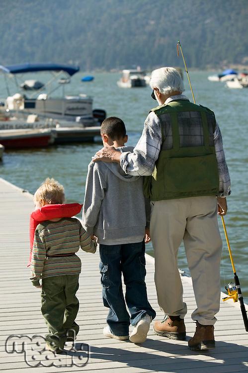 Grandfather Taking Grandsons Fishing