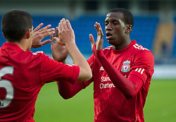 MOLDE, NORWAY - Wednesday, September 7, 2011: Liverpool's captain Conor Coady celebrates scoring the third goal against Molde from the penalty spot with team-mate Michael Ngoo during the second NextGen Series Group 2 match at Aker Stadion. (Photo by Vegard Grott/Propaganda)