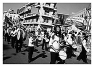 The Al-Amari Brass Band is marching the streets of the city centre of  Ramallah during a peace march on Music Day, protesting against internal Palestinian fighting. Ramallah, Palestine, 2007