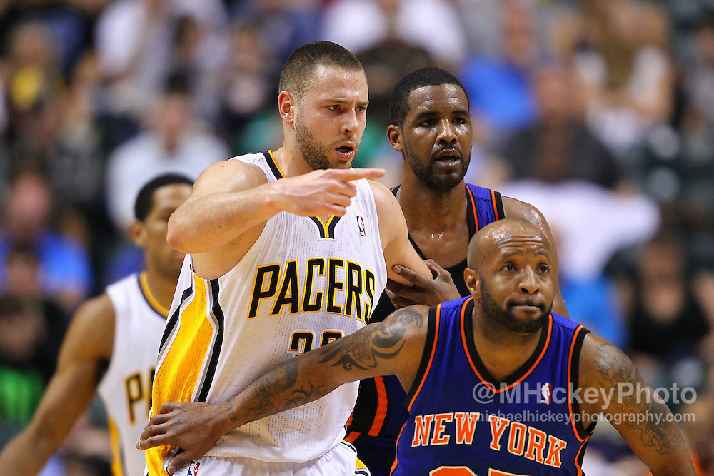 April 10, 2011; Indianapolis, IN, USA; Indiana Pacers forward Josh McRoberts (32) points a teammate on where to pass the ball against the New York Knicks at Conseco Fieldhouse. Mandatory credit: Michael Hickey-US PRESSWIRE