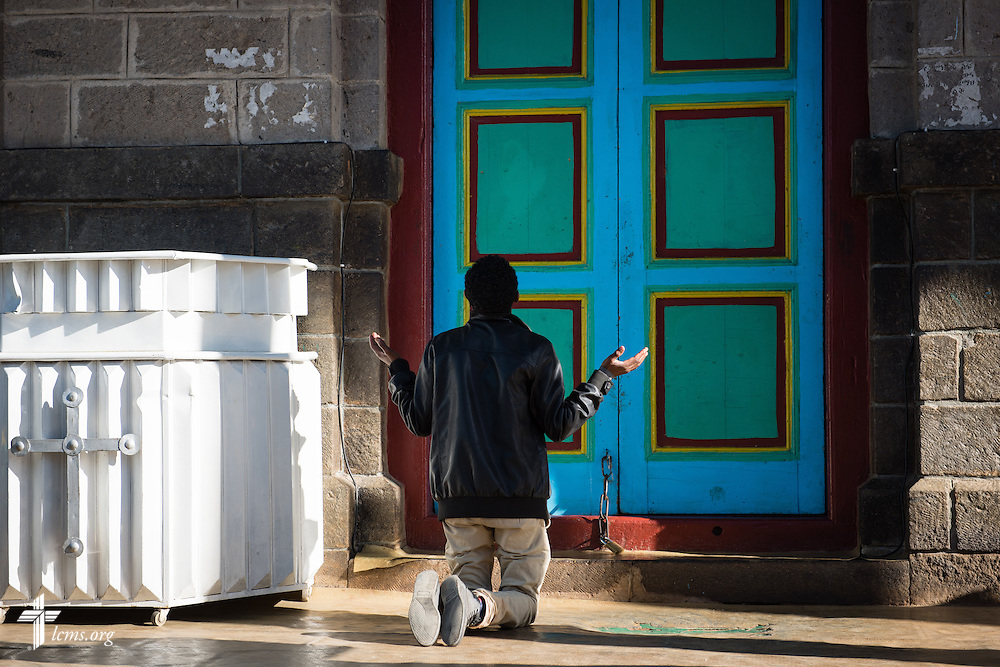 A man prays at the Entoto Maryam Church, on the foot of Mount Entoto in Addis Ababa, Ethiopia, on Sunday, Nov. 9, 2014. LCMS Communications/Erik M. Lunsford