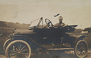 A man sitting in his car. 1920?s.