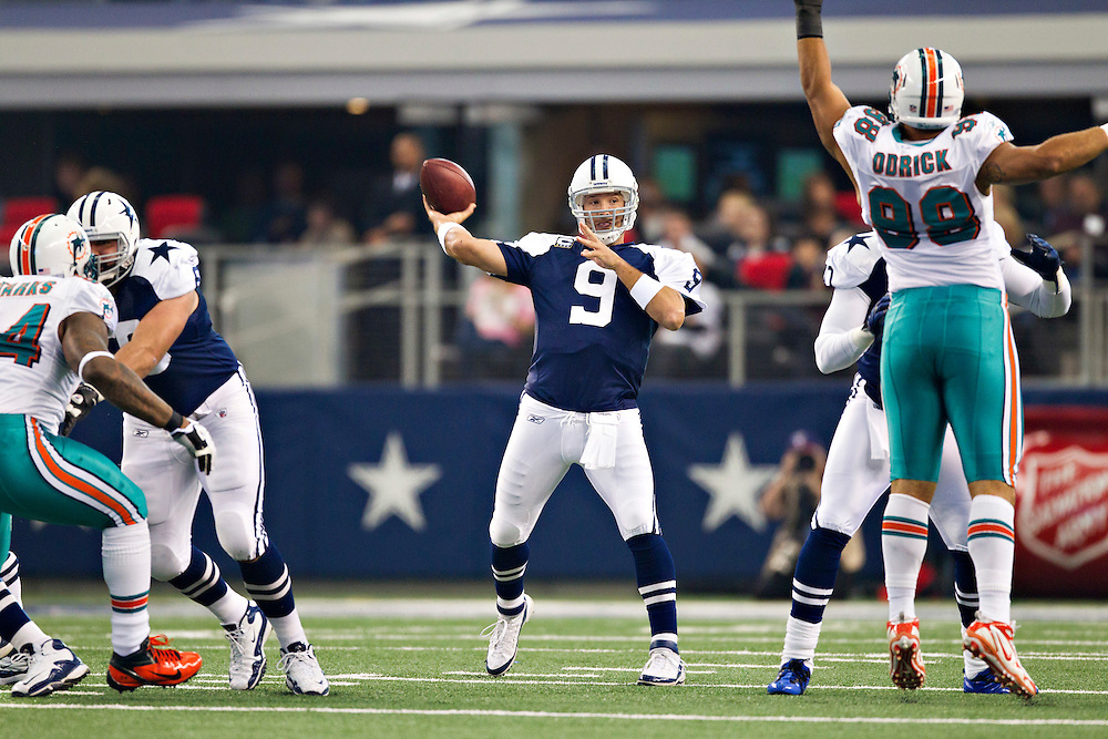 ARLINGTON, TX - NOVEMBER 24:   Tony Romo #9 of the Dallas Cowboys throws a pass against the Miami Dolphins at Cowboys Stadium on November 24, 2011 in Arlington, Texas.  The Cowboys defeated the Dolphins  20 to 19.  (Photo by Wesley Hitt/Getty Images) *** Local Caption *** Tony Romo