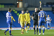 Brighton defender, full back, Liam Rosenior (23)  gets a yellow card and a caution during the Sky Bet Championship match between Brighton and Hove Albion and Leeds United at the American Express Community Stadium, Brighton and Hove, England on 29 February 2016. Photo by Simon Davies.