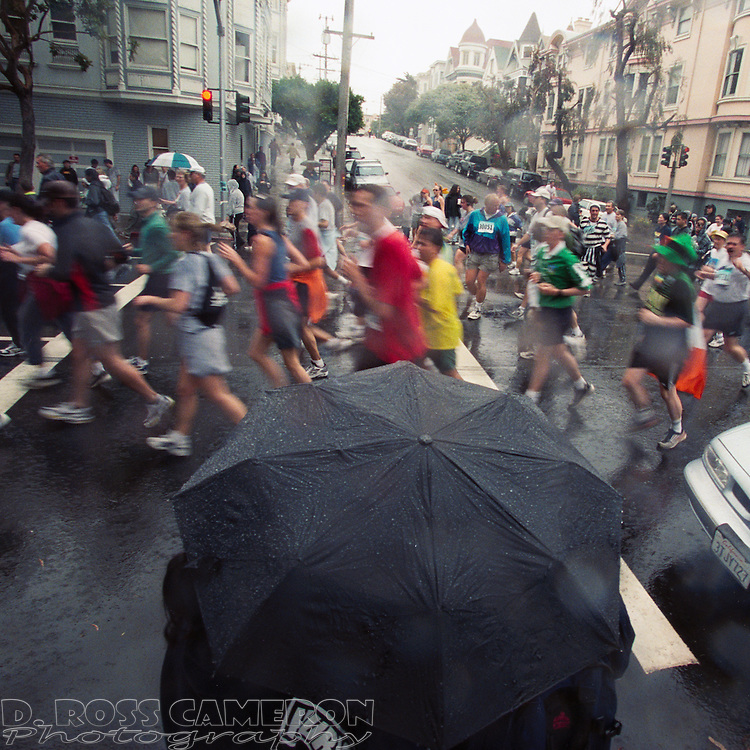 The umbrellas were out -- for both the runners and the spectators -- at the 91st annual Bay to Breakers 12K race, Sunday, May 19, 2002 in San Francisco. (Photo by D. Ross Cameron)