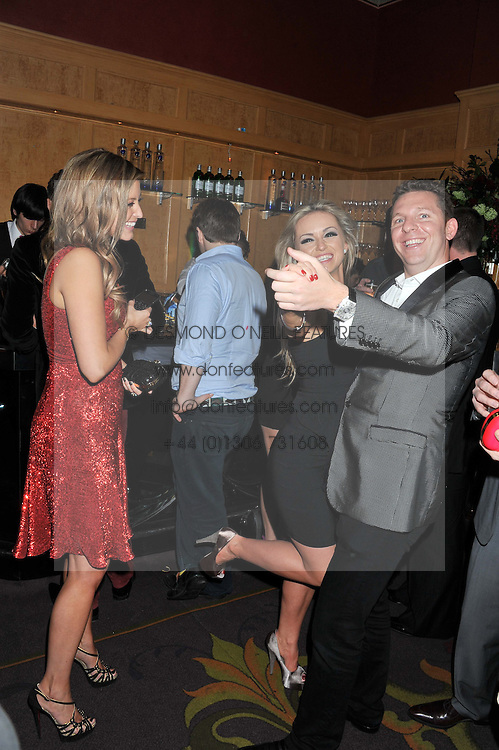 Left to right, HOLLY VALANCE, OLA JORDAN and NICK CANDY at the 39th birthday party for Nick Candy in association with Ciroc Vodka held at 5 Cavindish Square, London on 21st Januatu 2012.