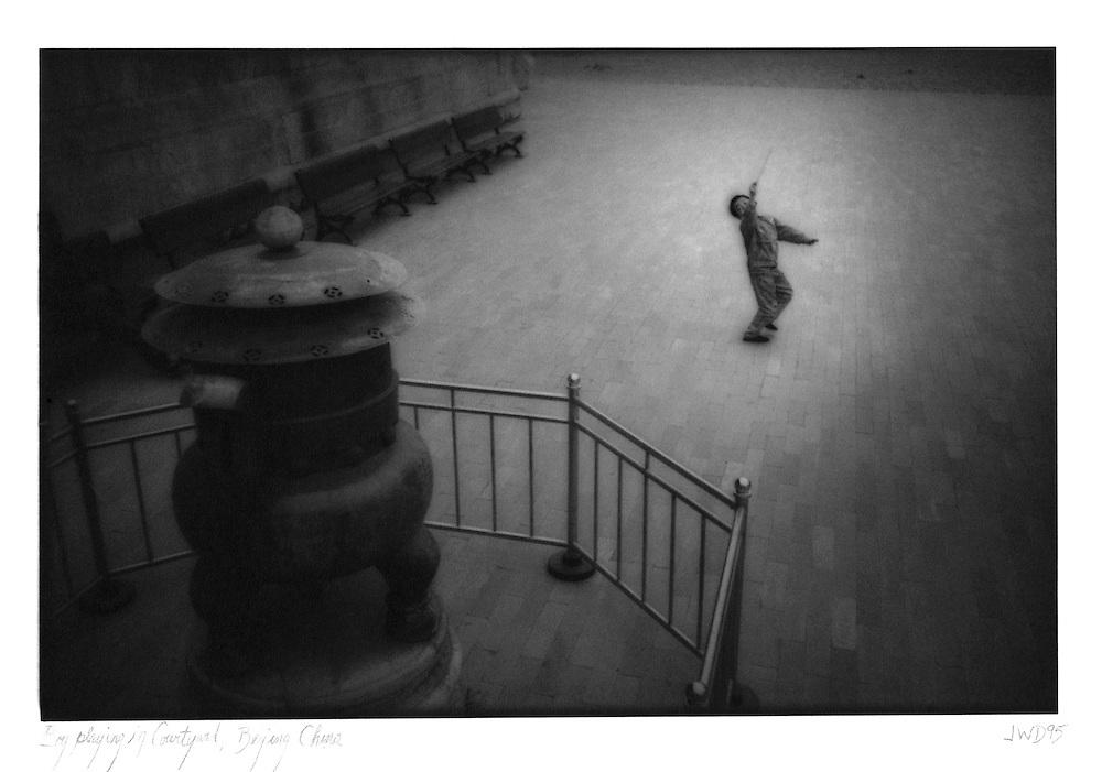 Boy playing in courtyard, Beijing, China 1994