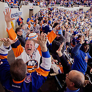 LONG ISLAND, NY - APRIL 11, 2015: New York Islanders fans celebrate a goal in the third period during their final regular season game at the Nassau Coliseum. CREDIT: Sam Hodgson for The New York Times
