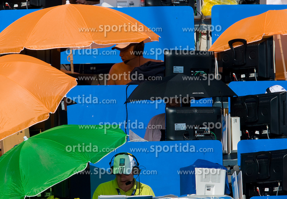 TV commentators under umbrellas during the 13th FINA World Championships Roma 2009, on July 28, 2009, at the Stadio del Nuoto,  in Foro Italico, Rome, Italy. (Photo by Vid Ponikvar / Sportida)