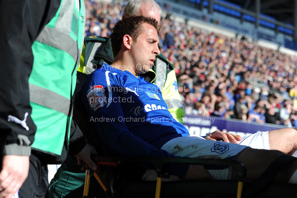 Cardiff city's Michael Chopra is injured and has to leave on a stretcher.  NPower championship match, Cardiff city v Barnsley at the Cardiff city stadium in Cardiff, South Wales on Sunday 13th March 2011. pic by Andrew Orchard, Andrew Orchard sports photography,