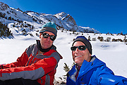 Backcountry skiers taking a lunch break under Piute Pass, Inyo National Forest, Sierra Nevada Mountains, California