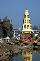 India, Nasik, 2006. Late morning at the Ramkund, which holds water from the Godavari River. Pilgrims visit this holy place from all over India.