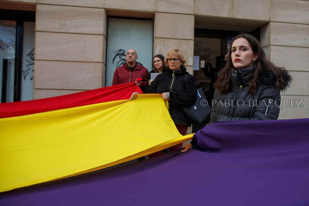14/04/2018. Relatives and supporters hold a Spanish Republican flag during a homage to hand victims of Spain Civil War bodies exhumed in Cobertelada and Calata&ntilde;azor to their relatives on April 14, 2018 in Soria, Spain. La Asociacion Soriana Recuerdo y Dignidad (ASRD) 'The Soria Association for Memory and Dignity' celebrated a tribute to hand over the remains of civil war victims to their families. The Society of Sciences of ARANZADI helped with the research, exhumation and identification of the bodies, after villagers passed the information about the mass grave, 81 years after the assassination took place, to the ASRD. Seven people were assassinated around August 25, 1936 by Falangists, as part of General Francisco Franco armed forces, and buried in the 'Fosa de los Maestros' (Teachers Mass Grave) near Cobertelada, Soria, after being taken from prison of Almazan during the Spanish Civil War. Five of them were teachers in the region, and also friends of Spanish writer Antonio Machado. The other two still remain unidentified. Another body was assassinated by Falangists accompanied by a priest in 1936, and was exhumed on 23 September of 2017 near Calata&ntilde;azor, Soria. It belonged to Abundio Andaluz, a politician, lawyer and musician in Soria.<br /> Spain's Civil War took the lives of thousands of people on both sides, and civilians. But Franco continued his executions after the war has finished. Teachers, as part of the education sector, were often a target of Franco's forces. Spanish governments has never done anything to help the victims of the Civil War and Franco's dictatorship while there are still thousands of people missing in mass graves around the country. (&copy; Pablo Blazquez)