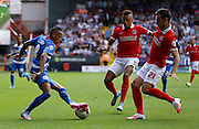 Tjaronn Chery looks to take on Morgan Fox during the Sky Bet Championship match between Charlton Athletic and Queens Park Rangers at The Valley, London, England on 8 August 2015. Photo by Andy Walter.